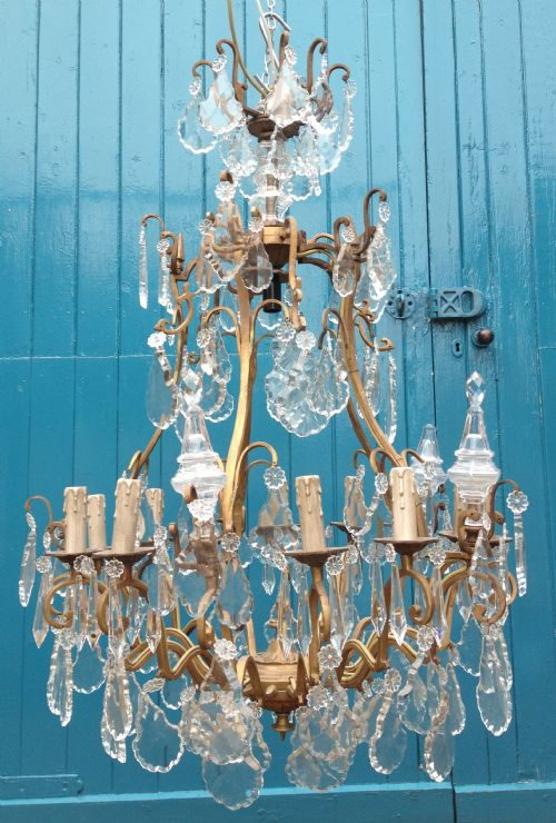 a large antique french cage chandelier