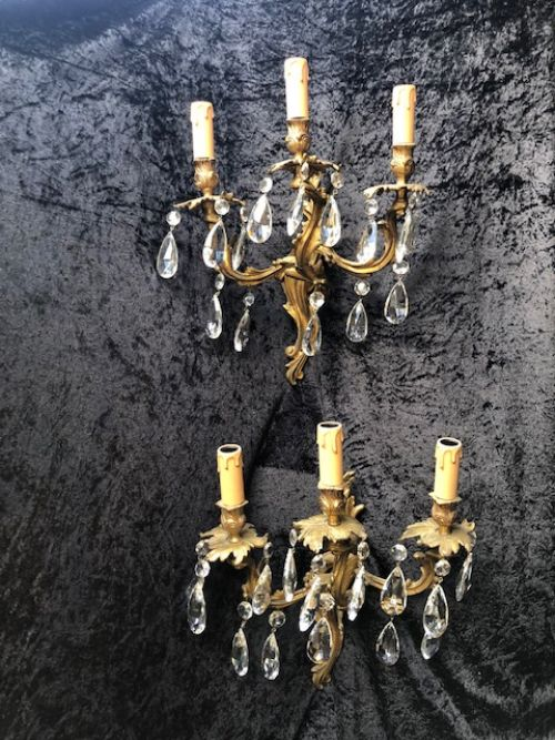 a pair of french rococo brass and crystal walllights