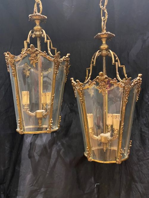 a pair of triple light ornate french antique lanterns