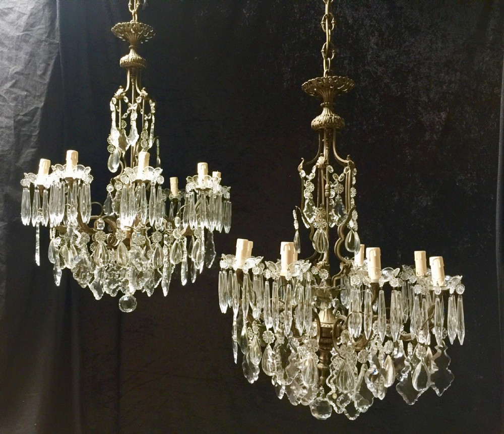 a super pair of antique italian dark framed eight light antique chandeliers
