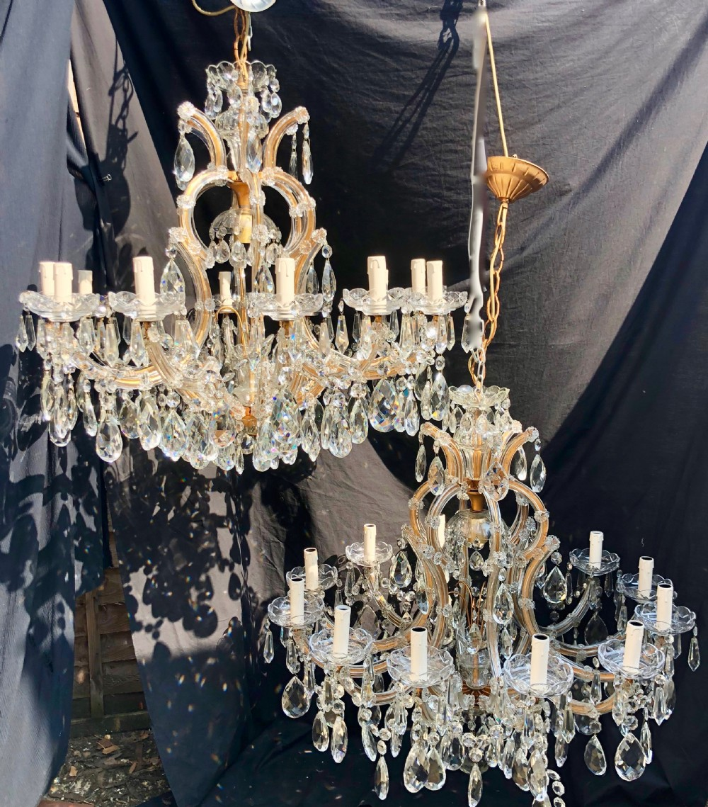 a pair of large italian marie theresa antique chandeliers