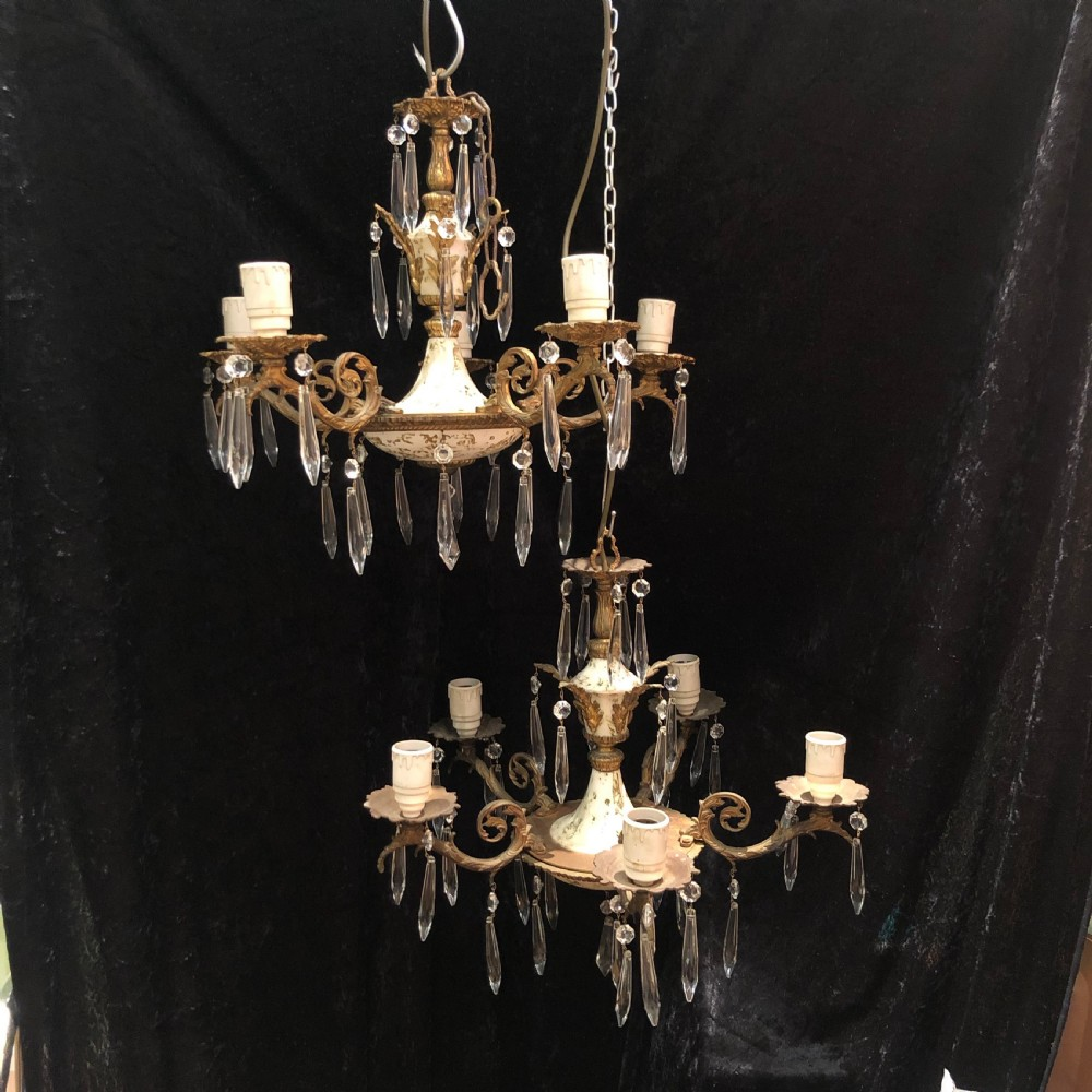 a pair of decorative italian antique chandeliers