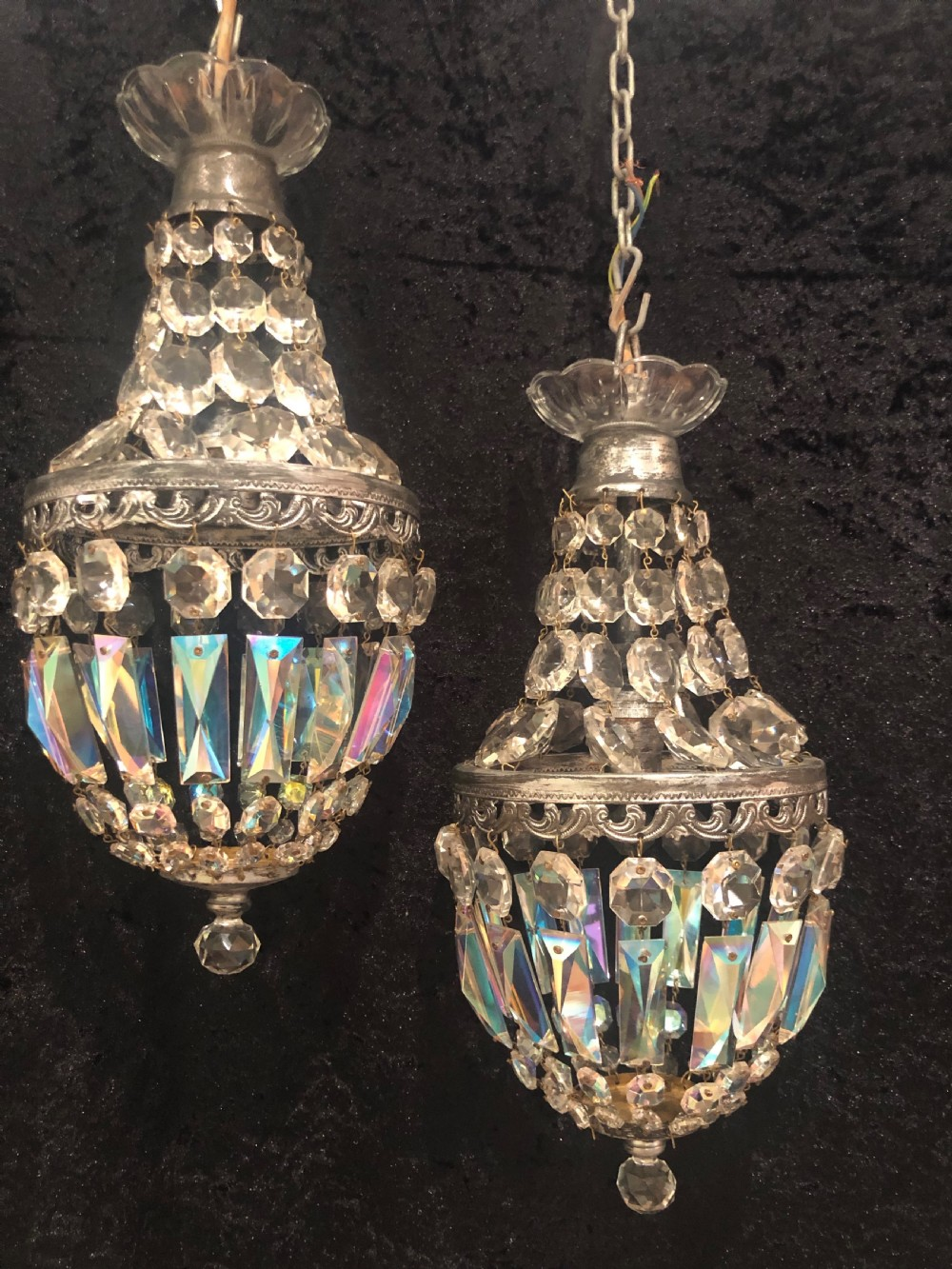 a pretty pair of small empire chandeliers with iridescent crystals